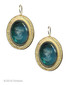 From our Mykonos Collection for Spring/Summer. Inspired by the beautiful waters of the Greek Island Mykonos. Shown in Gold Plate, transparent oval Zircon German glass intaglio earring. Measures approximately 1 inch by 3/4 inch. French Hook. 14k Gold Plate over bronze. Each earring made to order in the USA from the world's finest materials.
