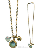 From our new Mykonos Collection. Inspired by the beautiful waters off the Greek Island of Mykonos. In Gold Plate, a darling style of one single Aqua German glass intaglio, a metal pomegranate, and one semi precious drop. Intaglio charm measures 5/8 inch in diameter. Necklace is 18 inches in length. Each necklace made to order in the USA.