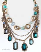 Our Zircon and Aqua hand pressed German glass intaglios in a gorgeous new blues color mix for any season. Shown here with Aqua, Periwinkle, Zircon and Moonstone glass mix in our popular charm necklace. With Czech glass beads.Largest charm measures just under one inch. Length 16 inches, adjustable to 20 inches. Bronze. Each necklace made to order in the U.S.A.