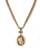 New for the Season, from our Victoriana Collection, a hand-carved Italian shell cameo necklace. Surrounded by beautiful freshwater pearls, in a classic Victorian design. Pendant is 1 inch by 3/4 inches and hangs from multistrand bronze chains at 16 inches in length. A graceful, pretty look. Red bronze.