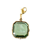 From our Charm du Jour Collection, a transparent Tourmaline German glass intaglio charm. The medium 3/4 inch wide charm comes with a lobster closure to attach to your own chain, or to one of ours, available from this website. Each charm made to order in the U.S.A.