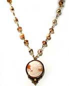 Elizabeth cameo necklace. New for the Season, hand-carved Italian shell cameo necklace, on strand of freshwater pearls, Czech glass beads, 17 inch length. Cameo is 1 1/4 inch (30mm) diameter. Very pretty.