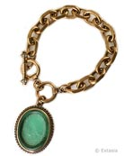New color for our single charm bracelet with an etched Seafoam green German glass cameo. Seafoam is our favorite new green! And one of our most popular new bracelets this year. Hand pressed in Germany, and etched to appear semi-transparent, the large Seafoam glass and metal charm measures 1 1/2 by 1 1/4 inches. This is a substantial bracelet, with chain links just over 1/2 inch in length. Total length of bracelet is 7 3/4 inches adjustable to 8 1/2 inches. Shown in our signature bronze, also available in Silver plate or Gold plate by request. Other colors  of glass by request. Each bracelet made to order in the U.S.A.