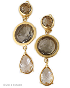 New from our Minerva Collection, for Spring a gorgeous clip earring in transparent Black Diamond  hand pressed German glass intaglios. Frosted Clear  German Glass faceted drop. Long clip earrings measure 2 1/2 inches in length. Very pretty! Shown in 14K Gold plated bronze. Each earring made to order in the U.S.A. rn
