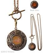 A double sided, reversible, double intaglio pendant necklace for this season.  With antique watch fob toggle is shown here in Maderia and Butterscotch and red bronze on delicate pony chain. Elegant and versatile! 1 1/4 inch diameter pendant. 30 inch chain. Bronze metal. Each necklace made to order in the USA.