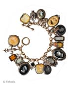 Our signature charm bracelet, the Charm du Jour bracelet, in a beautiful mix of colored German glass intaglios. Jet, Butterscotch, Slate, Black Diamond Mix. Length is 8 inches.