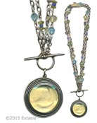 From our Scala Collection, our popular Convertible necklace in a transparent Jonquil German glass intaglio. Shown in Silver Plate. Large pendant measures 1 1/2 inches in diameter. Necklace of bronze, and semi-precious stones can be worn either as one  long strand at 34 inches, or short and doubled, at 17 inches. Shown in Antique Silver Plate over bronze metal. (Also avail. in Bronze, or 14kt Gold Plate by request. Each necklace made to order in the USA from the worlds finest materials.