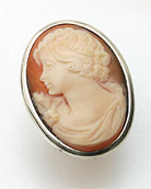 Large oval hand carved Italian shell cameo ring simply set has wide band shank. Sterling Silver setting. Cameo measures 1 1/4 by 1 inch.