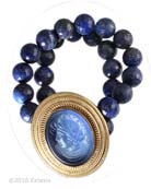 From our new Mykonos Collection for Spring/Summer. Inspired by the beautiful waters off the Greek Island of Mykonos. Translucent Sapphire German glass cameo with natural Lapis beading. Center measures 2 by 1 3/4 inches. Shown in 14k Gold Plate over bronze. Each bracelet made to order in the USA from the world's finest materials.