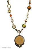 Our Arts and Crafts Collecton metalwork necklace in translucent butterscotch German glass intaglio mix. Perfect for fashion neutral palette.  Accented with smaller intaglios and freshwater pearls, and Czech glass beads. Shown in Bronze. 18 inch length, adjustable from 16 to 21 inches.