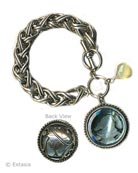 Hand pressed transparent Aqua German glass intaglio bracelet, shown in Silver Plate. From our classic Daughters of Dust Collection, a bold bracelet with one  large, beautiful intaglio charm.  Charm measures 1 1/4 inch in diameter, domed shape with lovely carved leaf motif on the back. One half inch wide chain bracelet is adjustable from 7 1/2 to 8 inches.  Each bracelet is made to order in the U.S.A.
