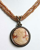 Large 30 mm hand carved Italian shell cameo pendant accented with three crystals on double strand of small freshwater pearls. 17""