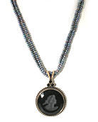 "From our Daughters of Dust Collection, classic jet German glass intaglio necklace on double strand of beautiful peacock freshwater pearls. Intaglio pendant is 1 1/4 inches diameter. Necklace is 17 inches length, adjustable to 20"". Shown in Bronze."