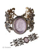 From our Fleur de Lis Collection, our translucent Pink hand-pressed German glass cameo set in a beautifully carved metal link bracelet. Cameo measures just under 1 3/4 inch by 1 1/4 inch wide. Metal link band is 1 3/4 inch wide. Bracelet is 7 1/2 long, but can be lengthened by request. In our signature bronze metal. Each bracelet made to order in the USA from the worlds finest materials.