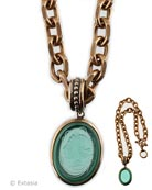 From our Minerva Collection, gorgeous Seamfoam green hand pressed German glass cameo pendant necklace. Cameo hangs from substantial medium weight 22 inch long bronze chain. Pendant is 1 1/8 by 1.5 inches. Seafoam is a semi transparent mint green. The color of the Spring Season. Shown in our signature Bronze metal. Each necklace made to order in the USA.