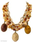 From our Minerva Collection, stunning three strand beaded necklace in rich Fall colors. We love this new color version! Mixed semi-precious and Czech glass beading, and three hand pressed German glass cameos in Ochre, Chocolate and Lava. Cameo images from Greek mythology. Necklace is adjustable from 15 inches to 21 inches. In our signature Bronze metal. Each necklace made to order in the U.S.A.