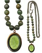 Sporty look with mixed metal and beaded necklace for a fresh seasonal look, over sweaters and Fall's heavier fabrics. Shown in an Olivine German glass cameo, with hand knotted dyed Jade beads. Necklace is 29 inches in length. Pendant is 1 1/2 by 1 1/4 inches. Shown in our signature bronze. Each necklace made to order in the USA from the world's finest materials.