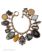 Our streamlined version of the Charm du Jour bracelet, in a gorgeous palette of neutrals and blacks. 15 charms, the largest is a 1 1/4 by 1 inch oval. A mix of opaque and transparent German glass cameos and intaglios,  including Slate, Jet, Ochre, Butterscotch, Dove Gray, Black Diamond and Smoky Topaz. Just over 7 1/2 inches in length, length can be adjusted by request. Shown in our signature Bronze, also available in Silver Plate and 14K Gold Plate. Each bracelet made to order in the USA.