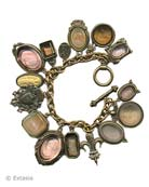 Our over the top charm bracelet. Shown here in a mix of Taupes and Neutrals, including our favorite Butterscotch. 15 hand pressed German glass cameos and intaglios and cameos. Measures almost 8 inches in length. Largest charm is 1 1/4 by 7/8 inch. Bronze, each bracelet made to order in the USA from the worlds finest materials.
