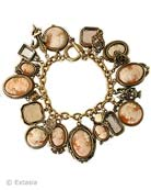 Beautiful hand-carved Italian shell cameos in this version of our classic 21 charm bracelet, the Charm du Jour.  Also includes several peach and taupe hand pressed German glass intaglios. Largest charm measures 1.25 inches long. Bracelet is 7 1/2 inches. Each bracelet lovingly made to order in the USA.