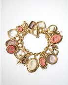 Our signature charm bracelet in a new Dusty Rose German glass intaglio and cameo combination. Very pretty in gold plate. 7 1/2 inch length.