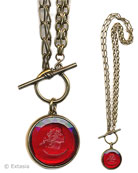 "Convertible necklace gets a little fancy with two kinds of chain.  Shown here with ""hand"" toggle with a transparent Cherry German glass intaglio, and convertible bronze chain at 36 or 18 inches. Can be worn as one long 36 inch necklace, or doubled as an 18 inch necklace. Large pendant is 1 1/4 inch in diameter."