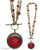 From our Scala Collection, our popular Convertible necklace in a transparent Cherry German glass intaglio. Large pendant measures 1 1/2 inches in diameter. Necklace of bronze, and semi-precious stones can be worn either as one  long strand at 34 inches, or short and doubled, at 17 inches.