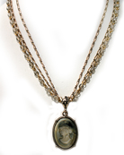Our slate hand pressed German glass intaglio on triple strand chain and rosary necklace. Pendant is 1 by 3/4 inch oval, necklace length is 17 inches.